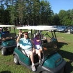 Seniors in Golf Carts during a Golf Outing at a Retirement Community
