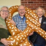 Happy Seniors Posing with a Blow-up Pretzel for an Event at an Award-Winning Retirement Community